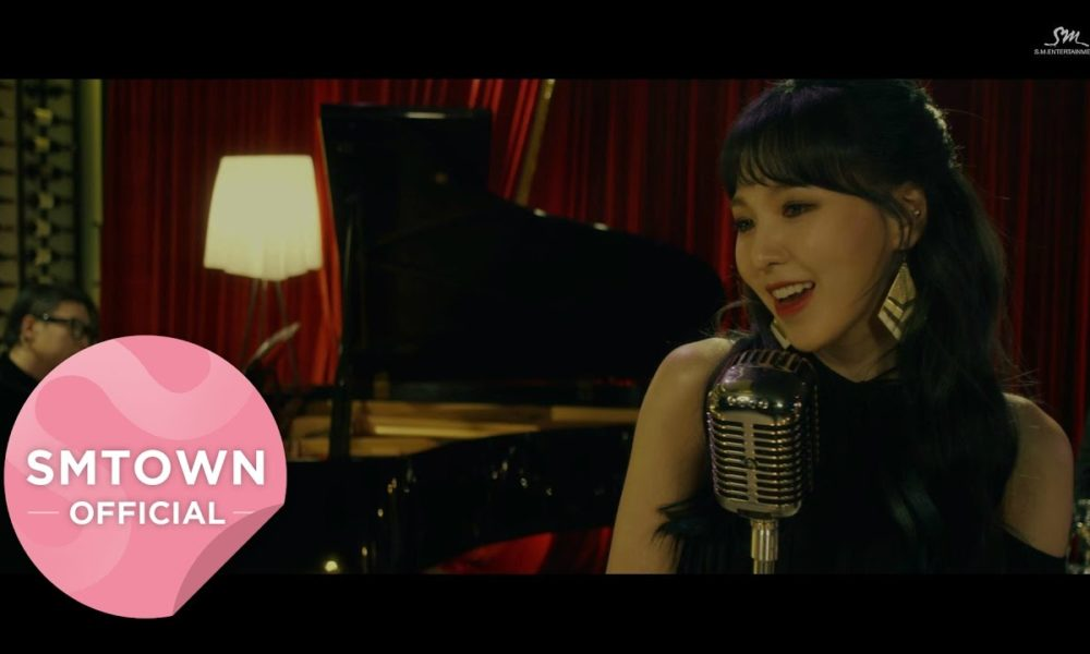 Wendy Red Velvet Nyanyikan Lagu Natal 'Have Yourself A Merry Little Christmas' di MV Baru 'STATION'